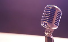 Image of a microphone over a largely neutral background.